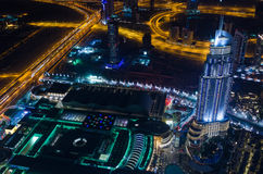 UAE, Dubai, 06/14/2015, downtown dubai futuristic city neon lights and sheik zayed road shot from the worlds tallest tower Royalty Free Stock Photos