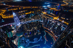UAE, Dubai, 06/14/2015, downtown dubai futuristic city neon lights and sheik zayed road shot from the worlds tallest tower Royalty Free Stock Images