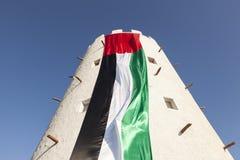 UAE flaga na wierza Obrazy Royalty Free