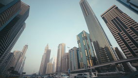 UAE, 2017: modern architecture and high buildings in Dubai. Skyscrapers with stained-glass facades in the UAE. Stone jungle: modern architecture and high stock video