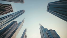 UAE, 2017: Skyscrapers with stained-glass facades in the UAE. Skyscrapers with stained-glass facades in the UAE. Stone jungle: modern architecture and high stock video footage