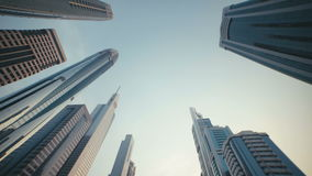 UAE, 2017: Tall Building Burj in Dubai. Skyline Cityscape City. Skyscrapers with stained-glass facades in the UAE. Stone jungle: modern architecture and high stock video footage