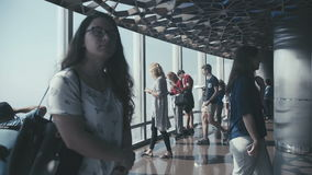 UAE, 2017: Tourists in front of the panoramic windows on skyscraper stock footage