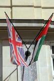 UAE Union Jack. Union Jack and United Arab Emirates Flags Together at Building royalty free stock photos