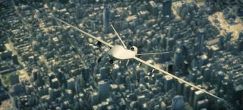 UAV armed reconnaissance and attack drone flying high above a metropolitan city. royalty free stock photo