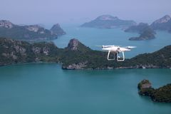 UAV or Drone camera fly up from the hands into the blue sky with. Ocean and island views on the mountain in Thailand Royalty Free Stock Photos