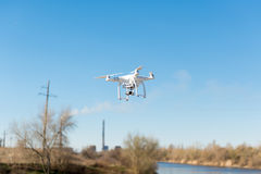 Uav drone copter flying with digital camera. Hexacopter drone with high resolution digital camera on the sky. The drone flies over. The strategic facility by a royalty free stock photography