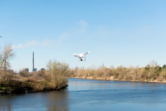 Uav drone copter flying with digital camera. Hexacopter drone with high resolution digital camera on the sky. The drone flies over. The strategic facility by a stock images