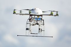 UAV drone flying. Uav robot drone flying in cloudy sky royalty free stock image