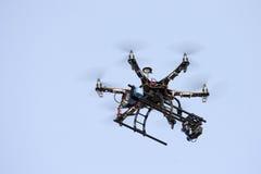 UAV DRONE IN SKY. Uav drone hexarotor flying in blue sky Royalty Free Stock Photography