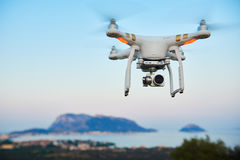 Free Uav Drone With Digital Camera Hover Sea Island Stock Images - 80017844