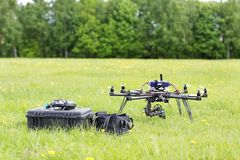 UAV Helicopter With Toolbox And Bag Royalty Free Stock Image