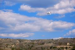 UAV in mountains. A UAV flies over the autumnal mountains in the sky royalty free stock photography