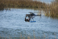 Uav over water. Remote controlled drone with camera over water Stock Photos