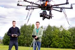 UAV Photography Drone. Professional team of a photographer and pilot operating a UAV Photography Drone Royalty Free Stock Image