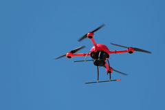 UAV. The reconnaissance UAV quadrocopter flying on the blue sky background royalty free stock images