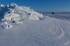 UAZ-452 near snow-covered ice hummocks of Lake Baikal Royalty Free Stock Images
