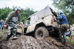Uaz 469 overcomes a muddy pit. LUBOTIN, UKRAINE - JULY 23, 2016: RFC Ukraine Wild Boar Challenge 2016. Uaz 469 overcomes a muddy pit Royalty Free Stock Photos