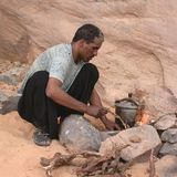 Man setting the fire in the desert royalty free stock images