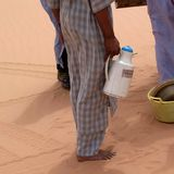Tuareg in the desert. Ubari Desert, Libya - May 04, 2002 : Tuareg in the Sahara desert Royalty Free Stock Photography