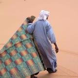 Tuareg in the desert. Ubari Desert, Libya - May 04, 2002 : Tuareg in the Sahara desert Royalty Free Stock Image