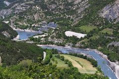 Ubaye River flowing to Lac de Serre-Ponçon, Hautes-Alpes, France. The Ubaye river rises at the Col de Longet, in the Cottian Alps in southeastern France on stock photos