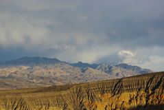 Ubehebe Crater and mountains. Under threatening skies, Death Valley, California Royalty Free Stock Photo