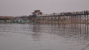 Ubein bridge in Mandalay, Myanmar. View of the Ubein bridge in Mandalay, Myanmar. U Bein Bridge is a crossing that spans the Taungthaman Lake near Amarapura in stock video footage