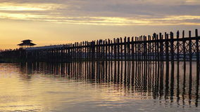 Ubein Bridge at sunrise, Mandalay, Myanmar. Silhouette of Ubein Bridge at sunrise, Mandalay, Myanmar stock video footage