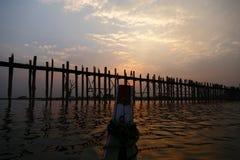 Uben Bridge. From the bow of the boat to see the bridgeUBen Bridge and myanmar people when sunset, at Amarapura Lake, Mandalay,Myanmar royalty free stock images