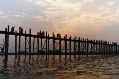 Uben Bridge. And myanmar people when sunset, at Amarapura Lake, Mandalay,Myanmar stock photos