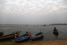 Uben Bridge. Wooden boat in Ubein Bridge at sunrise, Mandalay, Myanmar stock photo