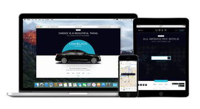Uber app on Apple iPhone, Macbook Pro and iPad displays Stock Photos