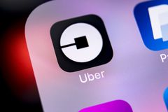 Uber application icon on Apple iPhone X screen close-up. Uber app icon. Uber is taxi car transportation application. royalty free stock photos