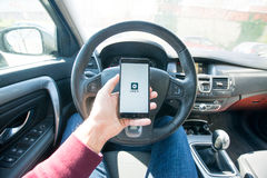 Uber application. Paris, France - march 31, 2017: Driver starting uber application with new logo Royalty Free Stock Photography