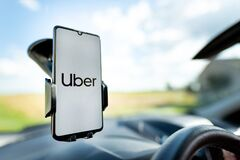 Free Uber Driver Holding Smartphone In Car Stock Photography - 195521382