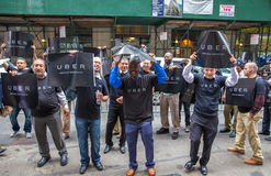 Uber drivers protest. Possible new Taxi and Limousine Commission oversight in New York - Dozens of drivers with the app-based ride service Uber rallied outside stock image