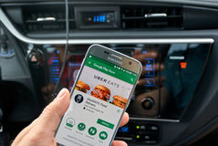 Uber Eats application on Samsung S7. MONTREAL, CANADA - AUGUST 22, 2017 : Uber Eats application on Samsung S7. Uber Technologies Inc. is an American technology stock photography