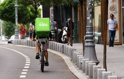 Uber Eats courier - Bucharest. Bucharest, Romania - August 01, 2018: An Uber Eats courier delivers food in Bucharest, Romania royalty free stock images