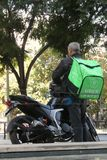 Uber Eats. A Uber Eats motorcycle driver in Santiago, Chile. Uber Eats is an online meal ordering and delivery platform launched by Uber Technologies Stock Photography