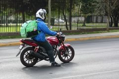Uber Eats. A Uber Eats motorcycle driver in Santiago, Chile. Uber Eats is an online meal ordering and delivery platform launched by Uber Technologies Stock Images