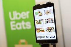 Uber mange le menu d'appli images libres de droits