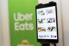 Uber mange le menu d'appli photographie stock