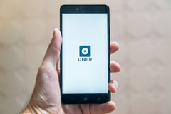 Uber. Nitra, Slovakia - March 24, 2017: Uber application new logo on smartphone stock image