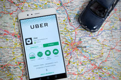 Uber sharing economy service in Wroclaw. WROCLAW, POLAND - JULY 20, 2017: Uber sharing economy service is frequently used form of urban transport in Wroclaw royalty free stock photo