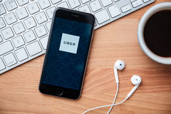 UBER is smartphone app-based transportation network. Bangkok,Thailand - June 15, 2016: Apple iPhone with UBER application on the screen. UBER is a smartphone Stock Photos