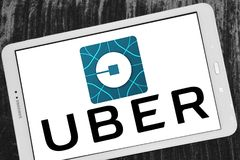 Uber taxi logo. Logo and icon of uber taxi company on samsung tabnUber app iPhone app store isolated Uber application startup page on Sumsung display background stock photography