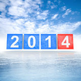 Сubes with new 2014 year number on ice. Frozen blue and red shining cubes with new 2014 year number on ice Royalty Free Stock Photography
