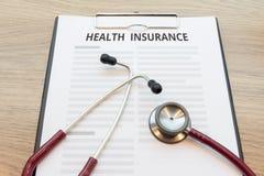 Ubezpieczenie zdrowotne forma z stetoskopem Zdjęcie Stock