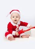 Ubierający jako Święty Mikołaj mały dziecko Obrazy Stock